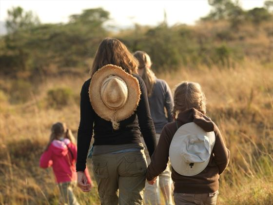 Family hiking through the Mara