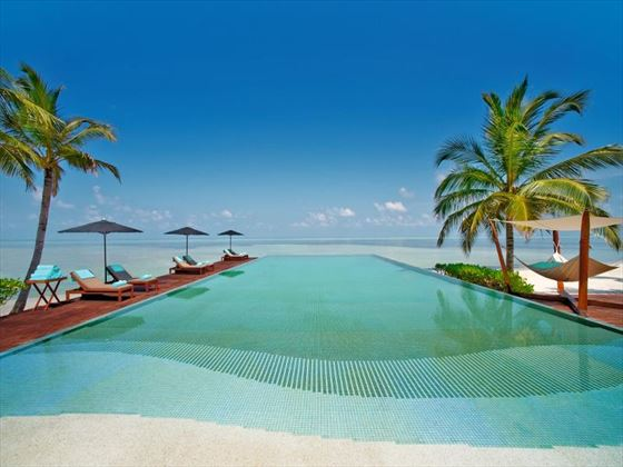 Lux Maldives pool and surrounding sun deck