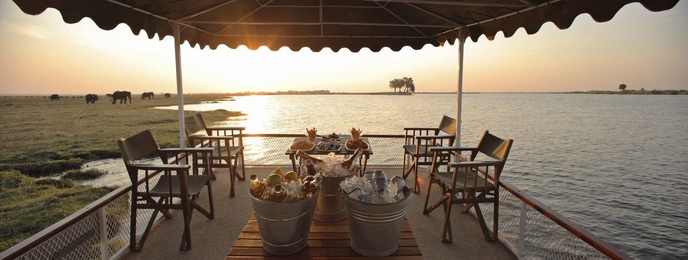 Dining on a boat - andBeyond Chobe Under Canvas