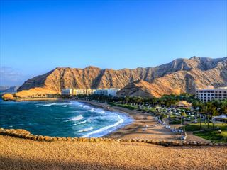 Beach and rugged mountains of Oman