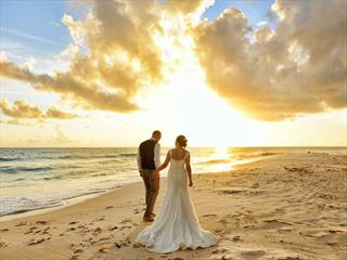 Beautiful sunset wedding at Sea Breeze Beach House