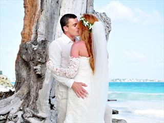 Bride & Groom on the beach at Bougainvillea