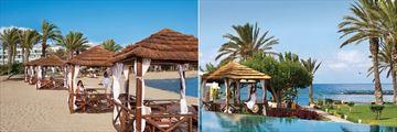 Beach cabanas and pool at Constantinou Bros Asimina Suites