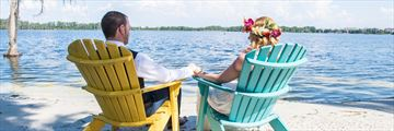 Bride and groom relaxing at Paradise Cove, Lake Buena Vista