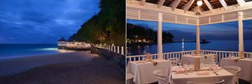 Evening view of over-water Bayside Restaurant at Couples Tower Isle