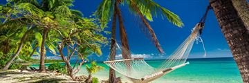 A secluded hammock on the beach in Fiji