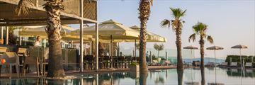 Outdoor pool and pool bar at Radisson Blu Resort & Spa