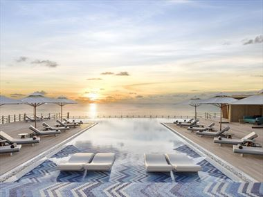 Pool at sunset at JW Marriott Maldives Resort & Spa