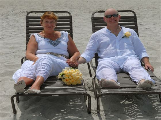 Hilton Cocoa Beach, Bride and groom on sunloungers