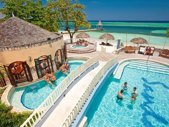 The pool and swim-up bar at Sandals Montego Bay