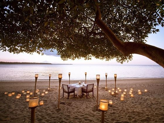 Dining on the beach at The Oberoi Beach Resort Lombok