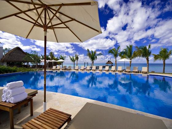 Guests will enjoy lounging by the pool just steps away from the picturesque beach