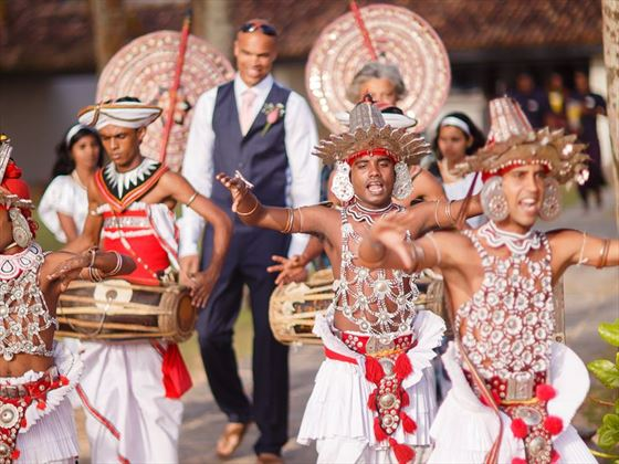 The Groom being escorted by Kandyan dancers & drummers
