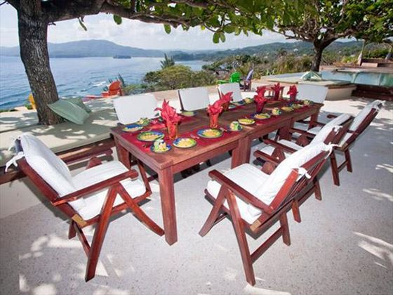 Dine al fresco with the beautiful backdrop of the Caribbean