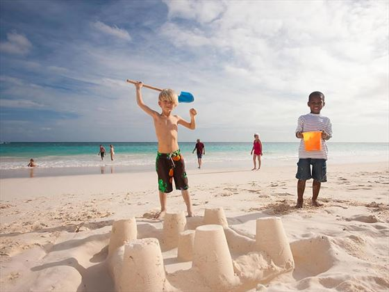 Building sandcastles on the beach at Bougainvillea Resort