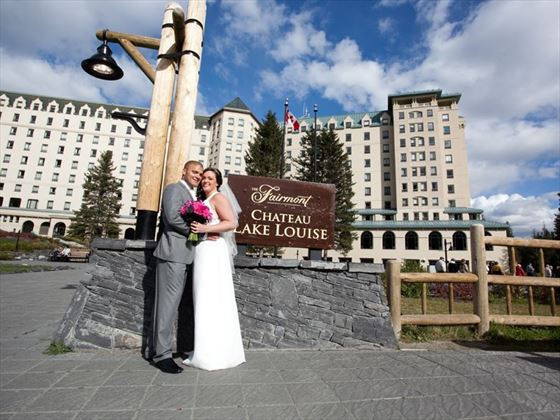 Bride & Groom pose outside the Fairmont Chateau Lake Louise