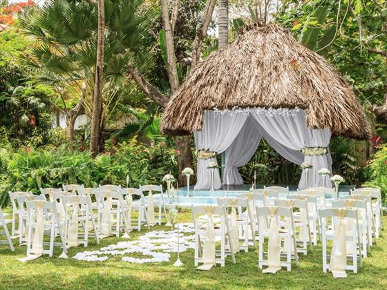 Couples Swept Away garden ceremony setting