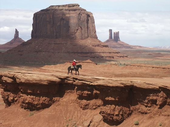 Cowboy riding the surreal landscape of Monument Valley