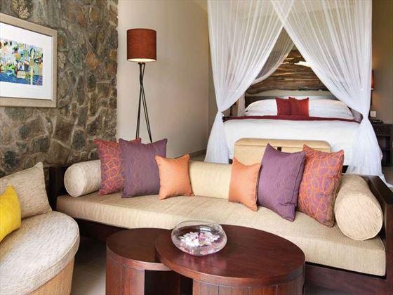 Deluxe beachside room at Kempinski Seychelles Resort