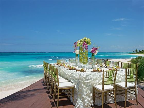 An elegant tropical reception setup on the beach