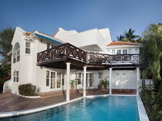 Exterior view of Windjammer Landing with adjoining pool