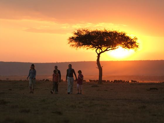 Family hiking through the Masai Mara