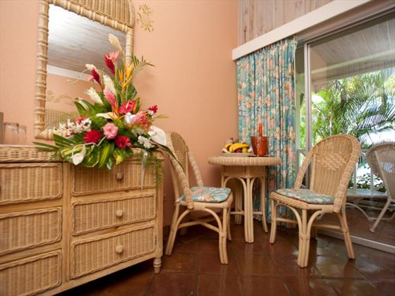 In-room seating area at Coco Reef Resort