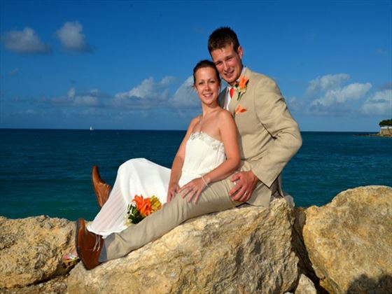 Bride & Groom pose for photos on the rocks