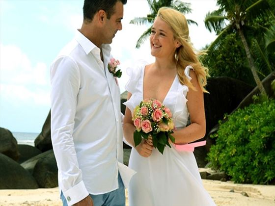 Bride & Groom saying vows on the beach at Hilton Seychelles Labriz