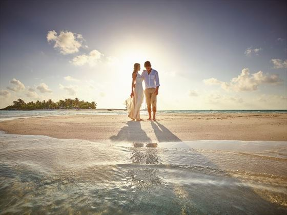 Married couple at sunset at LUX* South Ari Atoll