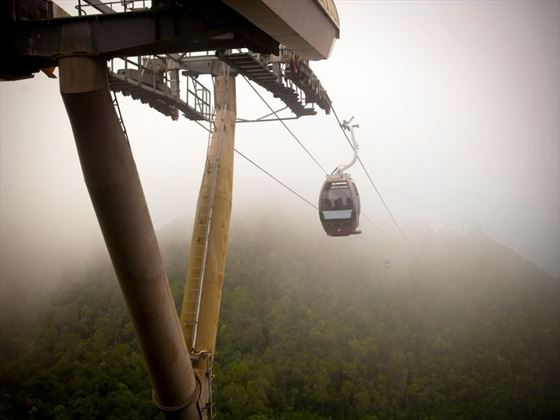 Cable cars travelling up the mountains