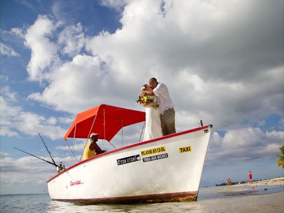 The bride and groom on a boat at Trou Aux Biches