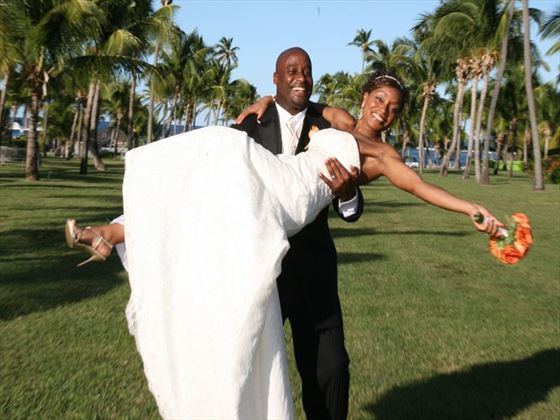 The happy wedding couple at Nisbet Plantation Beach Club
