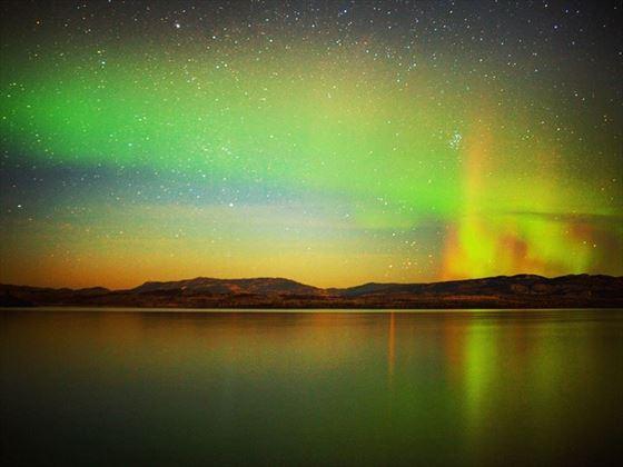 Northern Lights mirrored on Lake Laberge, Yukon