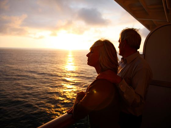 Admire the sunset as your cruise across the waters of Milford Sound