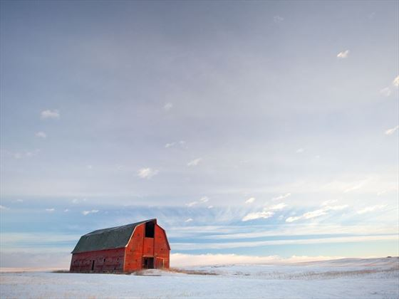 Old red barn on the prairies of Alberta