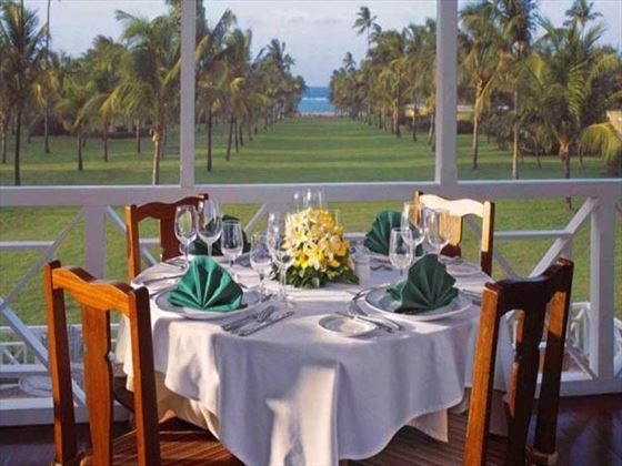 Outdoor dining at the Great House at Nisbet Plantation Beach Resort