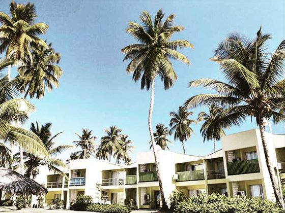 Palms sway at Turltle Beach Tobago by Rex Resorts