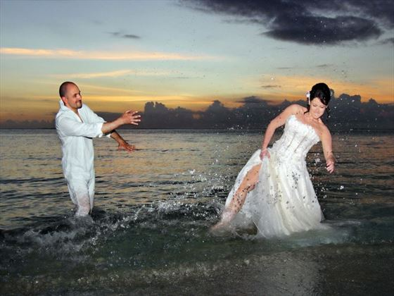 Bride & Groom in the waters at Paradis Hotel & Golf Club