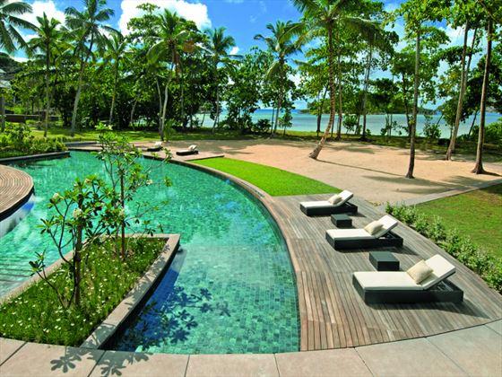 Pool and sun terrace at Constance Ephelia Resort