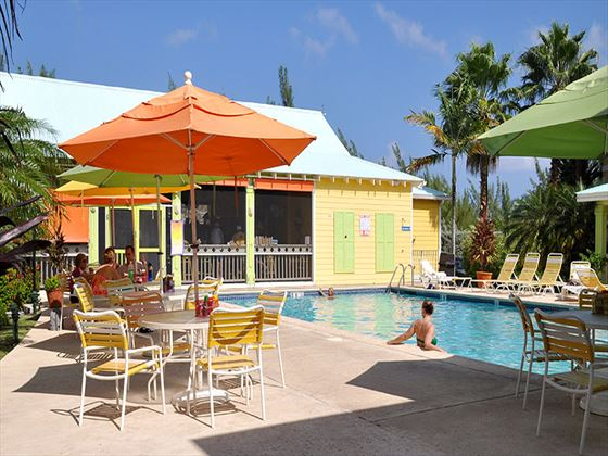 Pool and surrounding seating at Sunshine Suites Cayman Islands