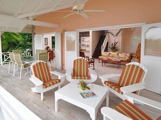 Wrap around veranda with seating and dining area