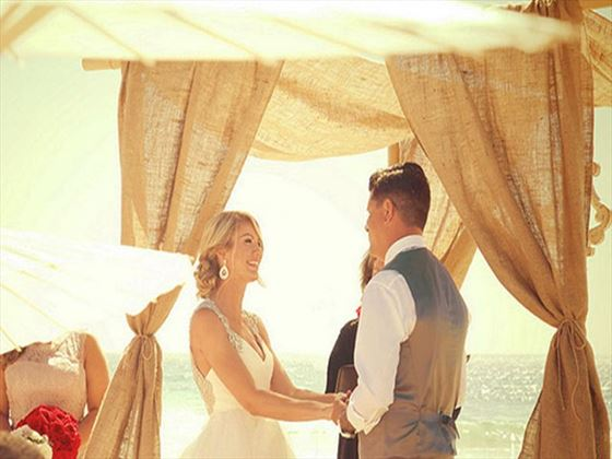 Beach wedding ceremony at Samabe Bali Resort & Villas