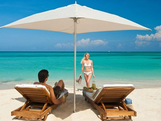 Enjoy the calm waters of Montego Bay beneath a shaded chaise