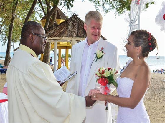 Wedding couple enjoying beach wedding at the Sugar Cane Club Hotel & Spa