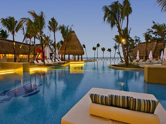 Swimming pool at night at Ambre Resort & Spa