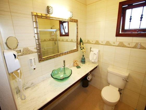 Typical bathroom at Sugar Cane Club Hotel & Spa