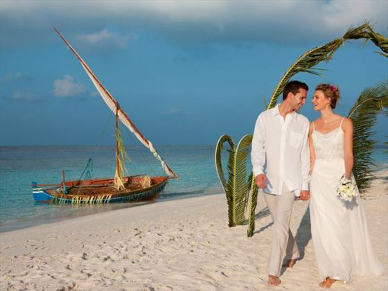 Couple on the beach at Vilamendhoo Island Resort & Spa