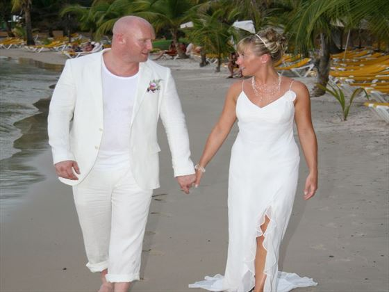 Walking on the sands at Coco Reef Resort