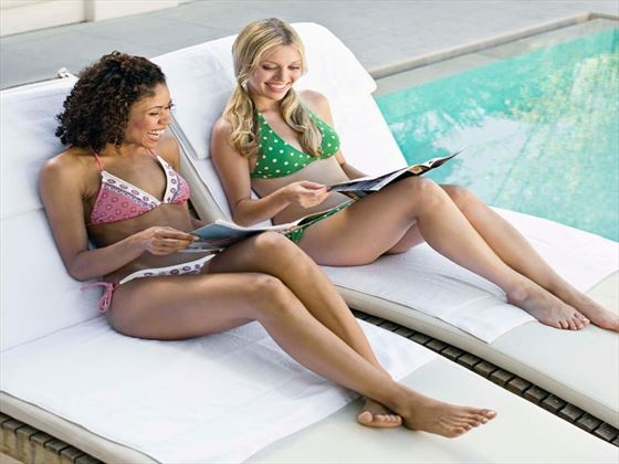 Relax with friends by one of the stunning resort pools on your adult only getaway